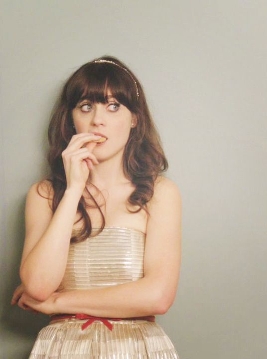"""""""eating cookies and avoiding confrontation"""" - Zooey Deschanel 