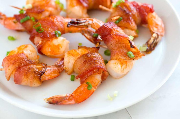 Quick and easy bacon wrapped shrimp recipe with a spicy maple glaze made with Sriracha and maple syrup.