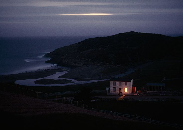 "slanting: ""A solitary fisherman's home keeps watch on quiet Placentia Bay in Newfoundland, Canada, 1974.Photograph by Sam Abell, National Geographic Creative """