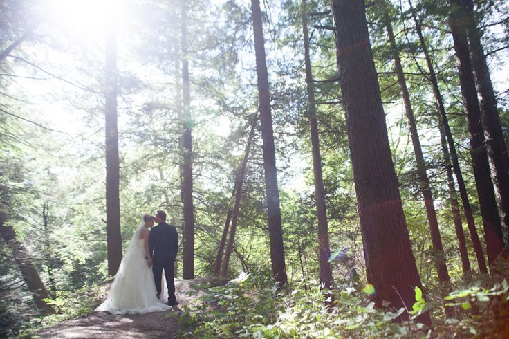 McMichael Art Museum bride and groom among tall trees