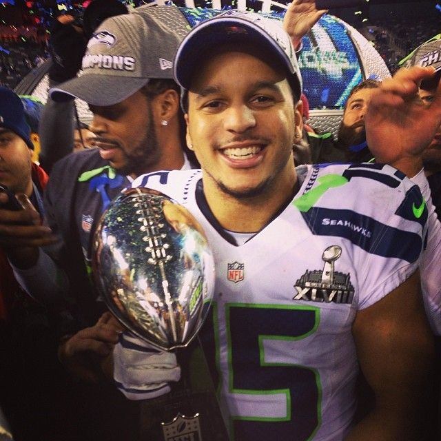 Husky Football Alum Jermaine Kearse with the Seattle Seahawks Super Bowl XLVIII trophy!