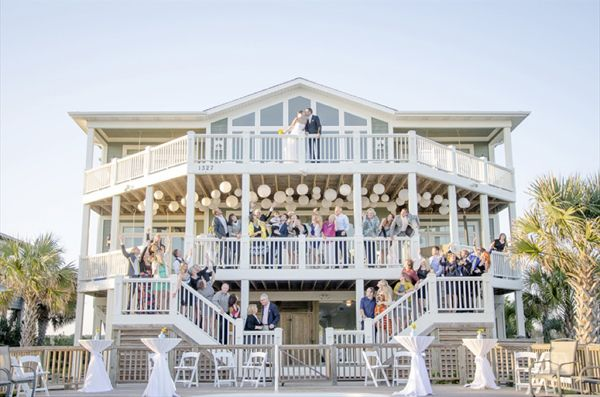 5 Inspiring Ideas for a Beach Themed Wedding Reception. What a great picture with a beach house!