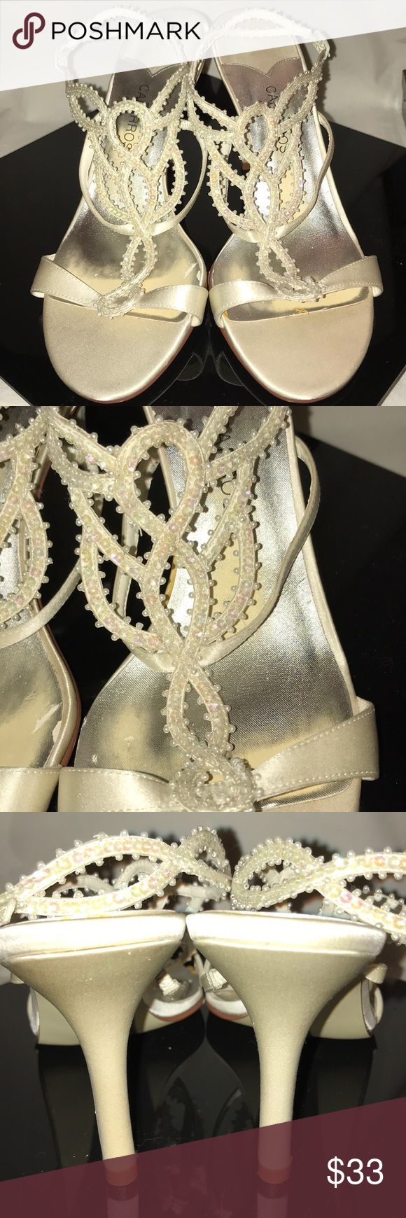 Caparros beaded, cream satin high heel sandals These beautiful ivory satin beaded sandals are reminiscent of Cinderella's shoes for the Ball (in sandal form!). They are very lightly worn, as evidenced by the leather soles.  8B. Caparros Shoes Heels