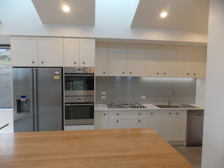 Kitchen - double oven, timber and white finishes