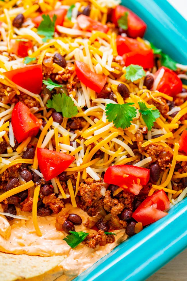 Layered Taco Dip Recipe Ready In 15 Minutes Averie Cooks Recipe Tacos Beef Taco Dip With Meat Ground Beef Tacos
