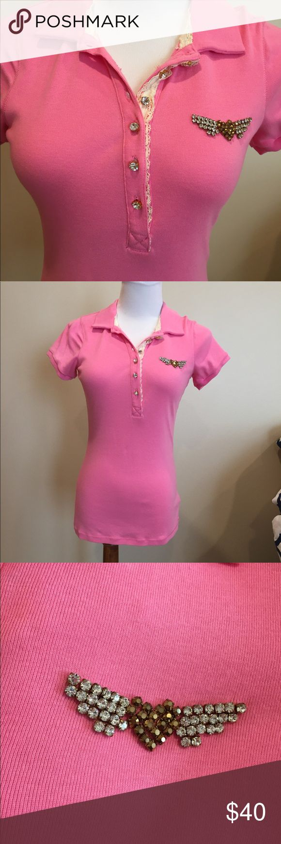 Twisted Heart Embellished Pink Polo Shirt NWOT Twisted Heart pink polo shirt with Rhinestone Heart and wings logo on chest. Lace trim and Rhinestone buttons. New, never worn. Size Small on a Size 4 mannequin as shown. Not your average, boring Polo! Just listed. TWISTED HEART Tops Tees - Short Sleeve