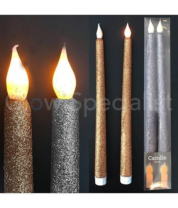 Led glitter kaarsen Zilver of goud. Feestleijk bij een gedekte tafel.