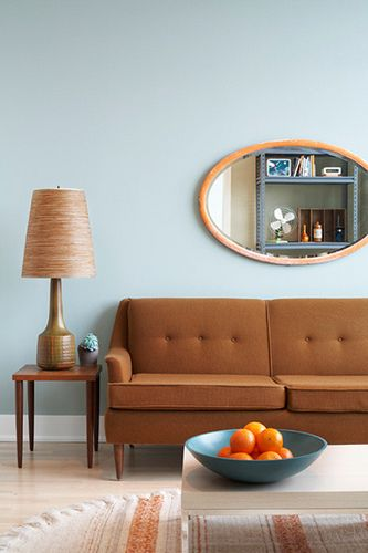 Retro still rocks! Freshen it up with an unexpected background shade--here a light blue (wall, accent items) keeps it from getting too earthy and becoming murky.