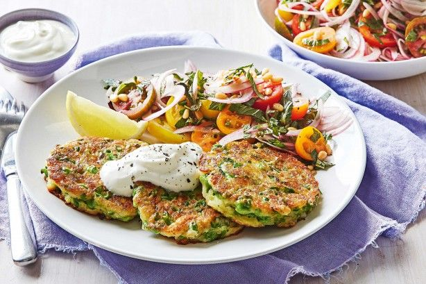 Satisfy hungry tummies with these golden haloumi and pea fritters served with a fresh tomato salad.