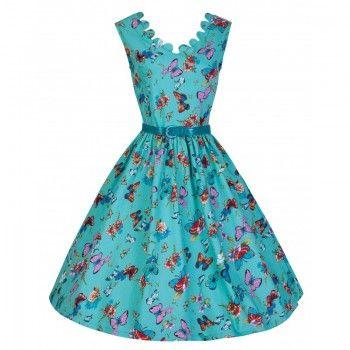De Daria dress heeft een wijde rok en een geschulpte V-hals. Aan de achterzijde is ook een V-hals, zodat je mooi je rug kunt laten zien. Deze versie is uitgevoerd in Turqoise stof met vlinderprint. De jurk is geheel gevoerd. Ritssluiting aan de achterkant. Lengte in maat M:94 cm.