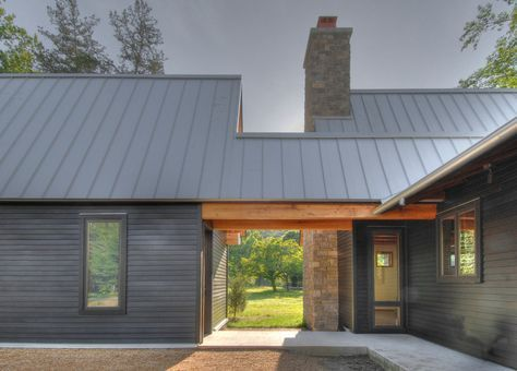 Metal roofing, low maintenance, crisp aesthetic and affordable. It can be site-fabricated, where the pans are formed from metal coil stock, or it can be premanufactured and arrive onsite already formed into pans. I like the look of natural Galvalume, a bright silver that dulls with age, and its natural patina protects the finish from corrosion. When that's not right for the project, I select a gray Galvalume that mimics a natural metal finish. Zinc Grey is a good default choice.