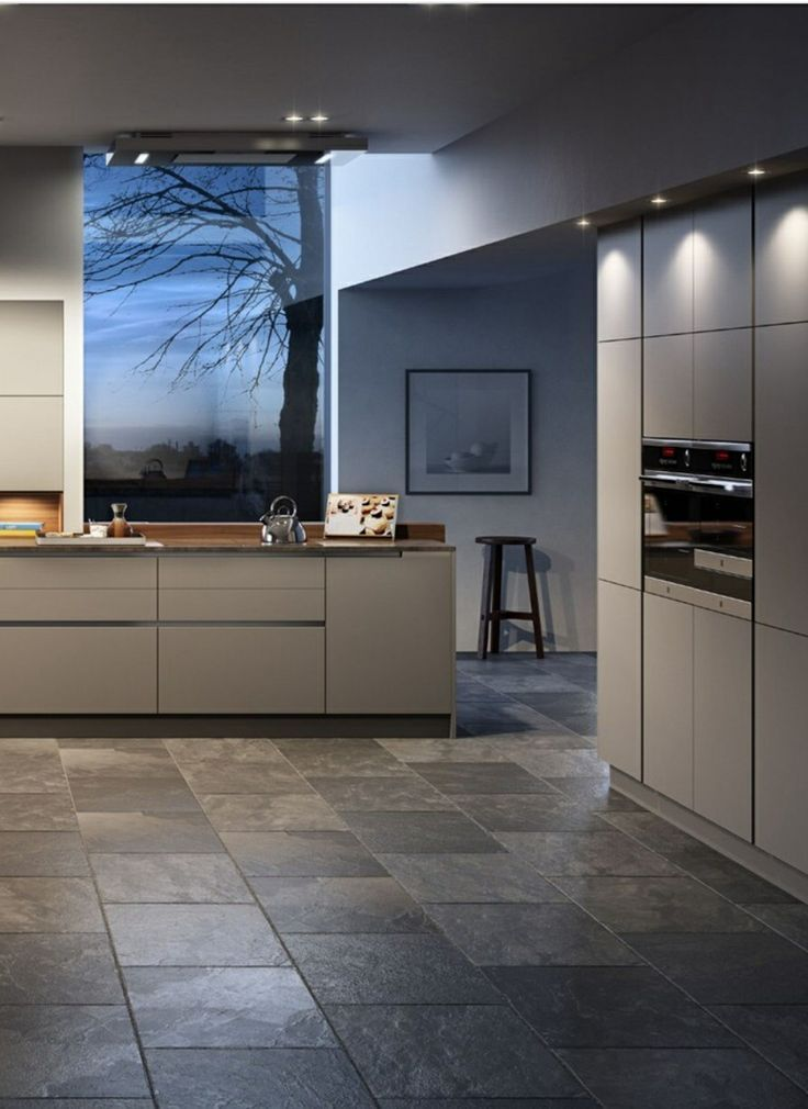 We like the way the tall units have a criss cross line at door levels poggenpohl kitchen
