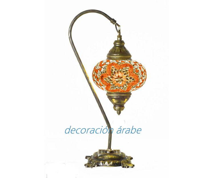 Bella lámpara de mesa turca de cristal de murano, con arco procedente de Turquía. Ideal para crear un ambiente íntimo y acogedor en su hogar. La parte metálica es de dorado envejecido, similar al color bronce  Medidas: 43 cm x 21 cm