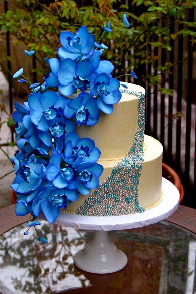 Cascading Blue Orchids Wedding Cake