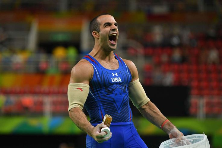Danell Leyva (USA) reacts after competing during the men's parallel bars final in the Rio 2016 Summer Olympic Games at Rio Olympic Arena.