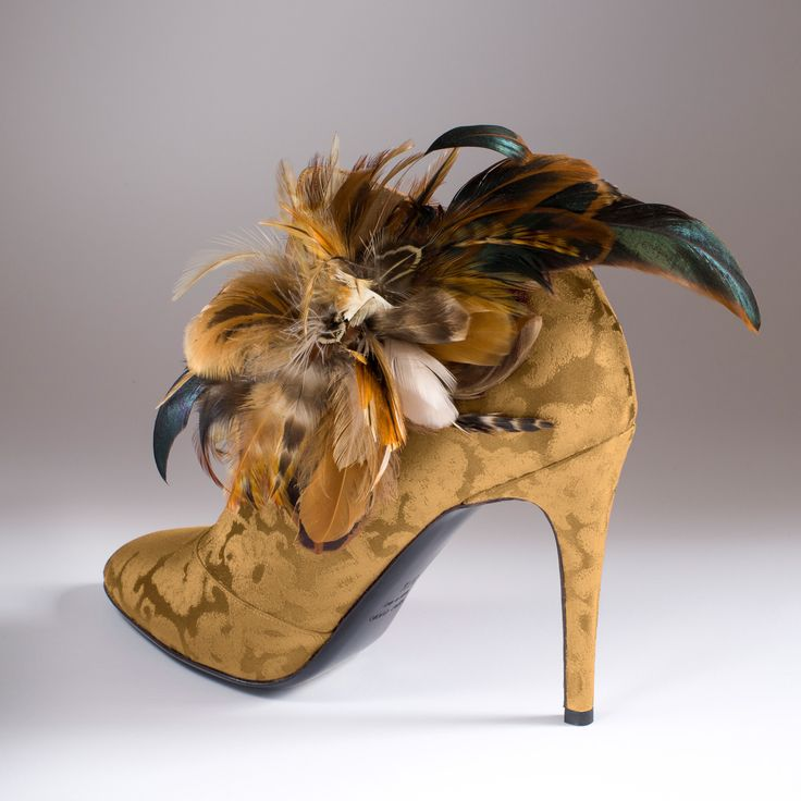 """""""La Belle Diane"""" in Rubelli gold silk brocade with """"Diana the Huntress"""" feathers  http://store.leschaussonsdelabelle.com"""