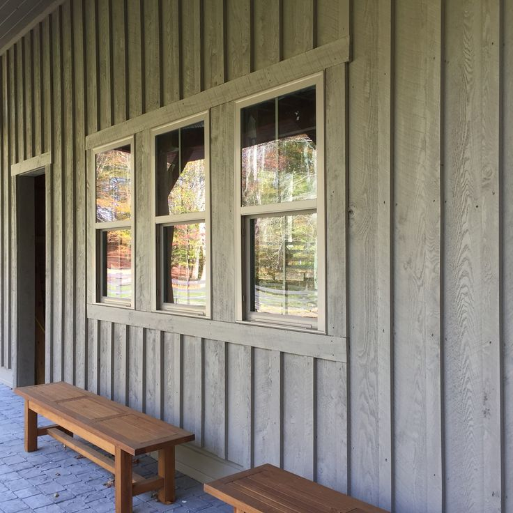 Barn with board and batten siding, front porch, benches, gray green hemlock and vinyl windows. Designed by Kerrin Muller, Muller Design Company, interior and exterior design, Fredericksburg, Virginia.