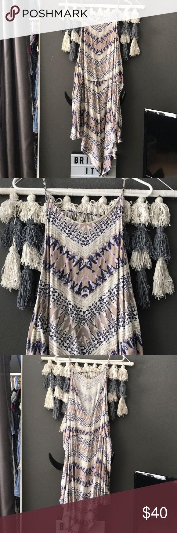 FREE PEOPLE TRIBAL HIGH LOW DRESS Summer is just around the corner, and boy is this dress the PERFECT summer (or spring) outfit 💃🏼 this is in great condition, it is a high low dress meaning it is short in the front and long in the back. Only worn a few times! Free People Dresses High Low