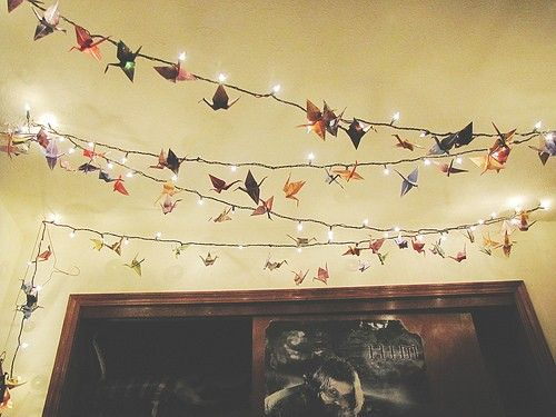 Paper cranes hung from fairy lights add a nice touch to an indie room!