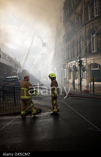 Harrogate, North Yorkshire, UK. 18 March 2014. Fire Services from North Yorkshire battle to put out a fire in shops in Albert Street in Harrogate Town Centre. © John Fryer/Alamy Live News