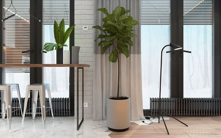 black-slatted-venetian-blinds-and-heater-work-space-trimmed-tree-high-wooden-bench