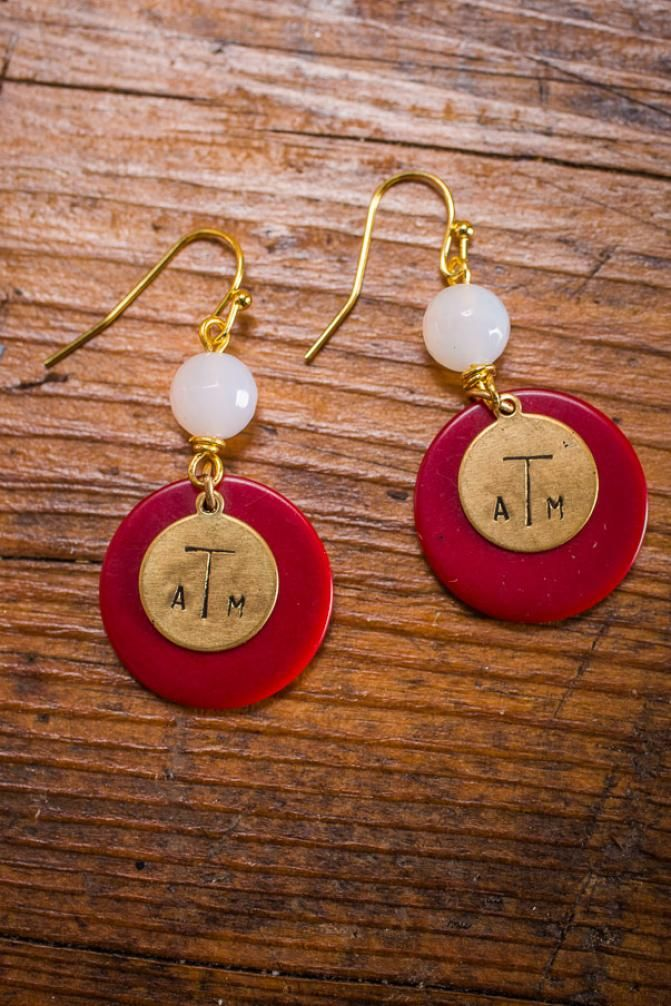 TAMU Game Day Earrings For these Maroon and White Texas Initial Earrings, a brass charm is paired with a maroon vintage mini poker chip and a white glass bead to create some serious school pride. Each charm is hand-stamped and then antiquated to bring out the design even more. Bourbon and Boots