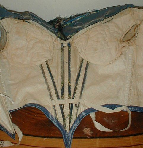 Early 1860s silk stripe evening body. Interior shows much more than the usual bust padding and a waist stay tape. Unkown Ebay seller.