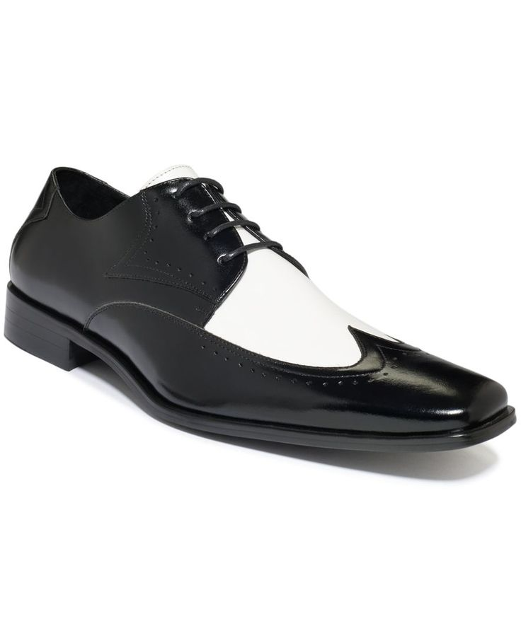 Black-tie will never be the same. Step into high style with a pair of two-tone wing-tip shoes from Stacy Adams.   Leather upper; man-made sole   Imported   Stacy Adams men's shoes   Wing tip   Broguin