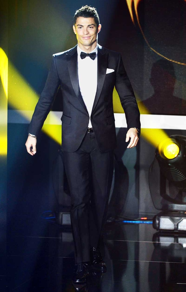 For his appearance at the FIFA Ballon d'Or awards at the Kongresshaus in Zurich on January 7, 2013, Real Madrid's Portuguese forward Cristiano Ronaldo chose to wear a tuxedo from the DSquared2 Classic Collection. (Photo by OLIVIER MORIN/AFP/Getty Images)