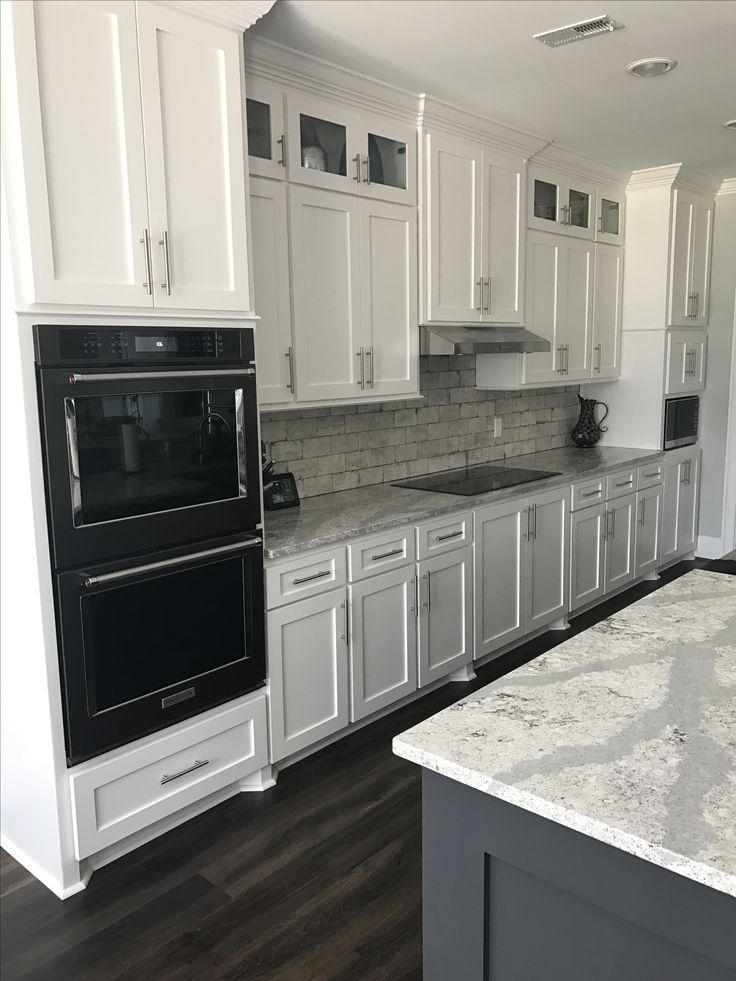 Black stainless Kitchenaid Appliances white cabinets  Craftsman style gray brick home  Kitchen