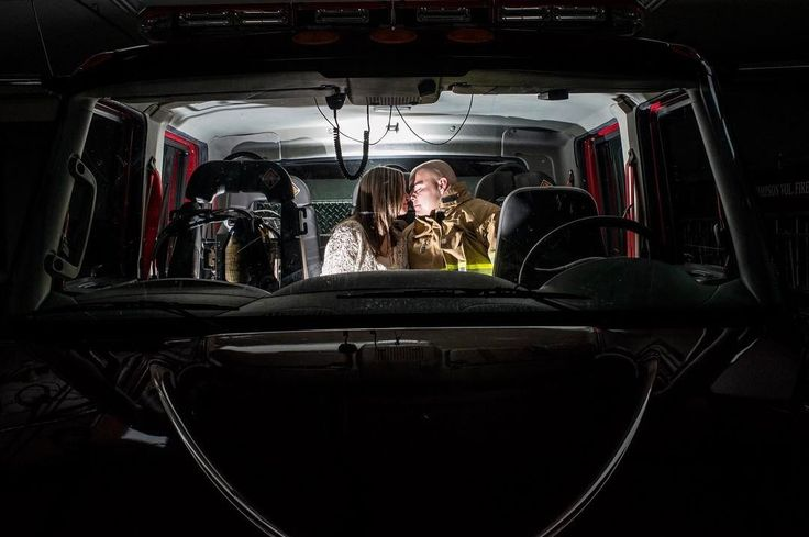 A firefighter and his fiancée getting cozy in the firetruck? Yes please :-). #howheasked#thedailywedding#theknot#lifeofaphotographer#justgoshoot #chasinglight#lookslikefilm #RisingTideChallenge  #engagement #engagementphotos #nikonphotography #inlove #firetruck #fireman