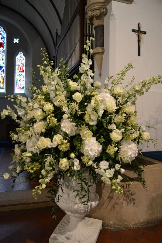 Church Urn flower arrangement using Delphinium, Hydrangea, avalanche roses, lisianthus