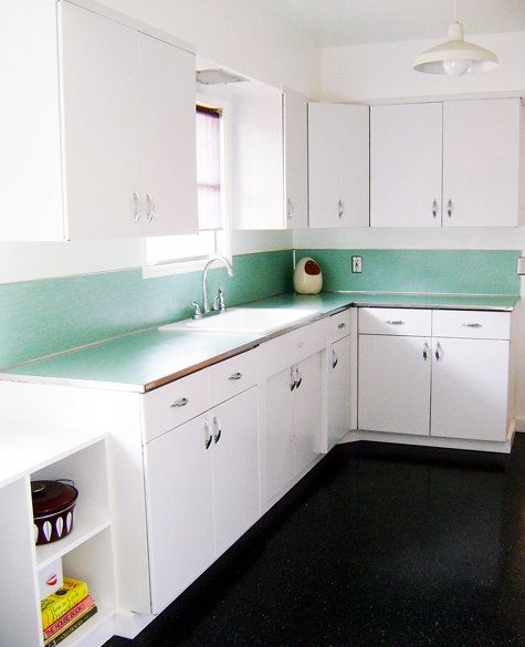 All white metal cabinets.  Ahhhhhhh. With a little nod to the vintage teal...
