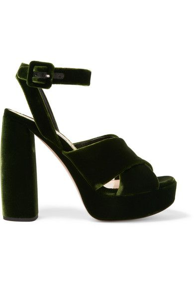 """""""Wearing velvet after dark is already a new-season no-brainer,"""" says The EDIT. Miu Miu's forest-green sandals have been crafted in Italy and designed with a sizable platform to balance the towering block heel. We think they look especially cool with cropped printed pants to complement the elegant ankle strap."""