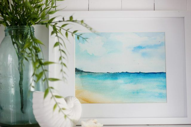 Framed watercolor beach scene.   LC:  Step by step on painting a watercolor beach scene that's far simpler than it looks.