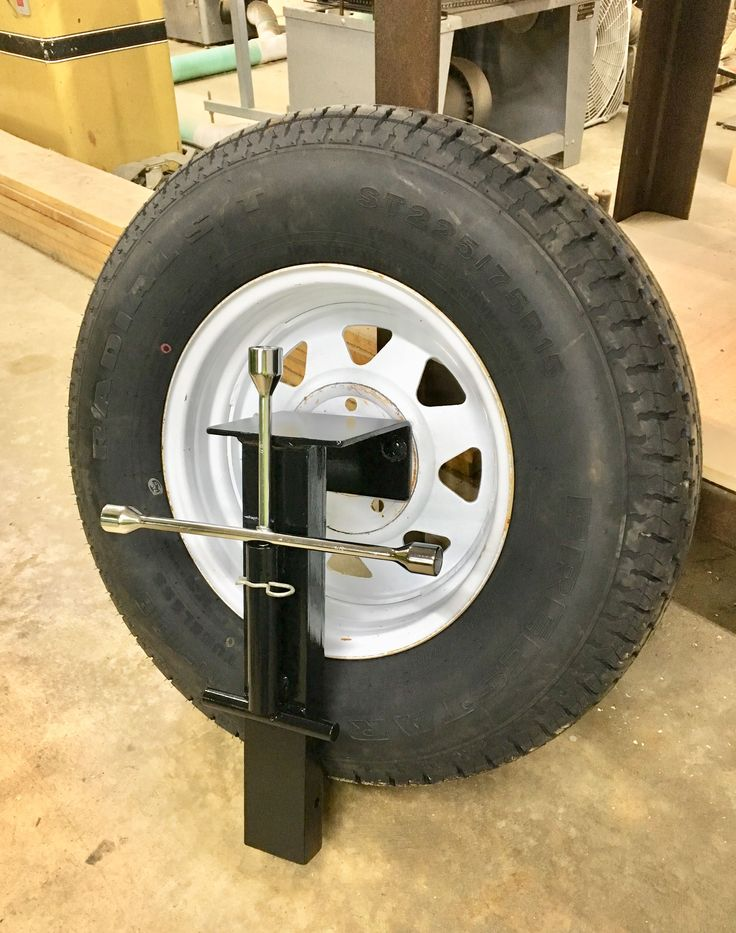 Spare tire holder fits in trailer stake pocket in 2020