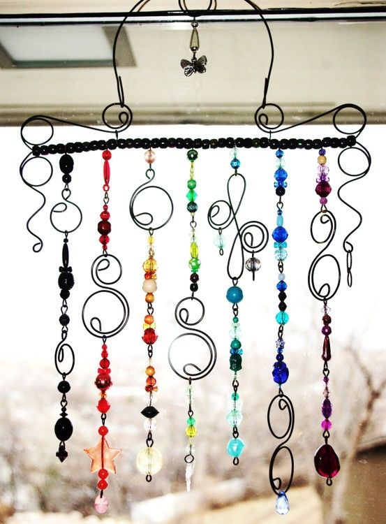 DIY wind chime, love the use of swirly metal. Don't know that I could make that myself without screwing it up!