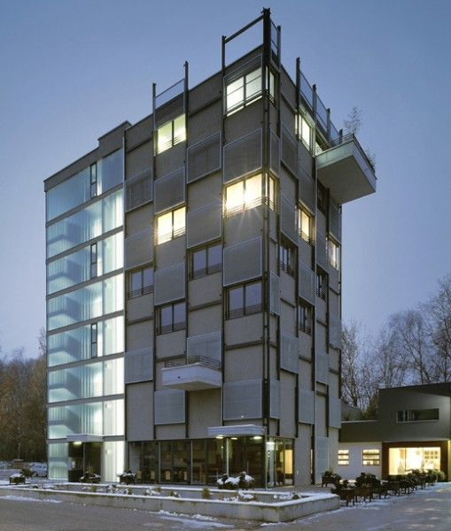 Büroturm Gusswerk by LP Architektur An eight-storey office tower with vertical movable sun shading devices, and a bistro on the ground floor.