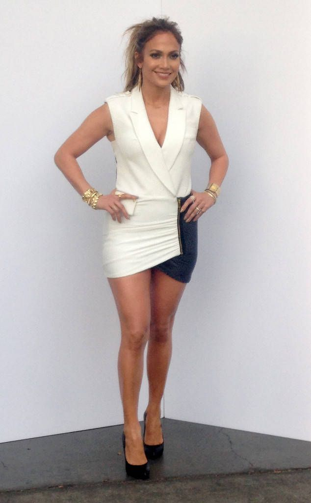 The American Idol judge flaunts her toned gams in this shimmery minidress.