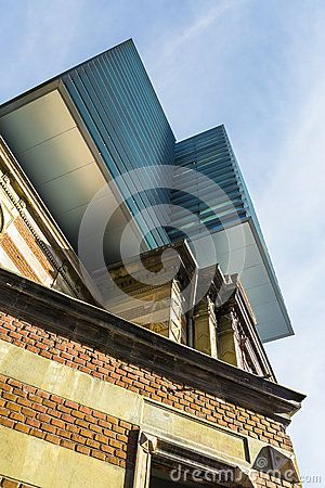 Upwards perspective view of classic and modern architectural concept building.
