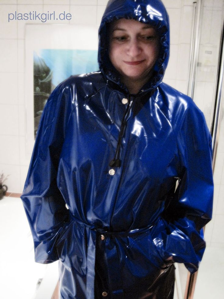gaby from duesseldorf wearing a shiny blue pvc raincoat real amateurs wearing pvc lack latex. Black Bedroom Furniture Sets. Home Design Ideas