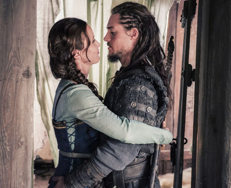 """Alexander Dreymon as Uhtred of Bebbanburg (with Peri Baumeister as Gisela) in """"The Last Kingdom"""" Season 2 From http://www.farfarawaysite.com/section/lastkingdom/gallery2/gallery5/gallery.htm"""