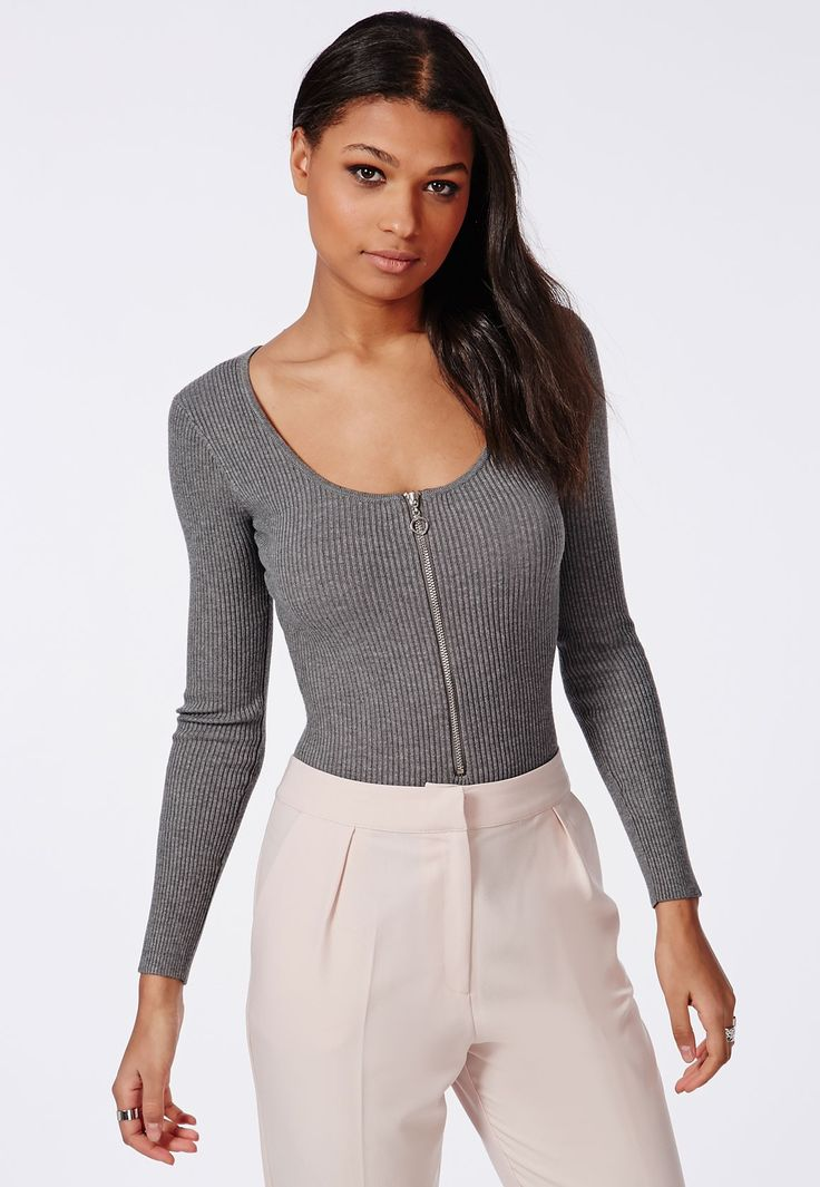 With a scoop neck and zip front detail this grey melange piece is uber versatile and works for day or night. Be chic and sexy in our luxe ribbed bodysuit. Style with skinny's, mom jeans or an a-line mini for a steady stream of bangin' outfi...