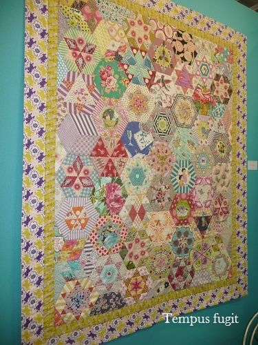Margaret Sampson-George: gorgeous quilt on a turquoise wall