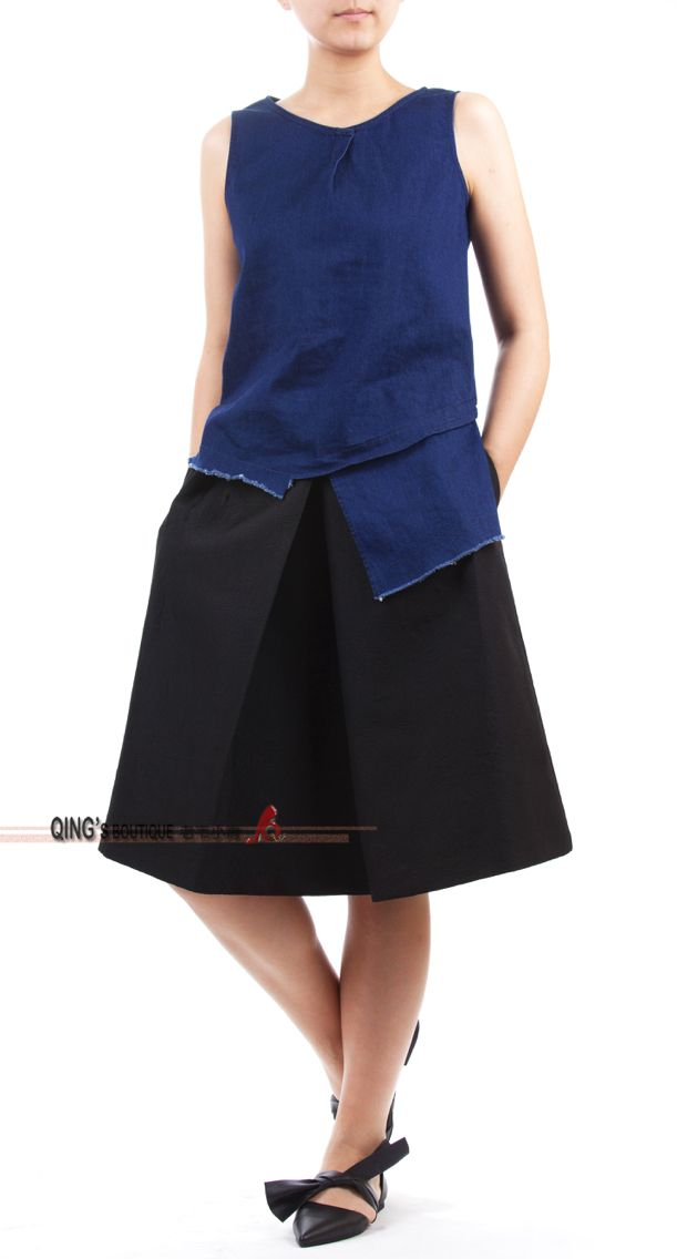 Asymmetrical denim top with black skirt.
