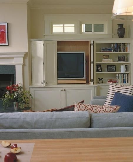 Living room: The TV can be concealed with retractable doors, so when not it use, can be hidden away.