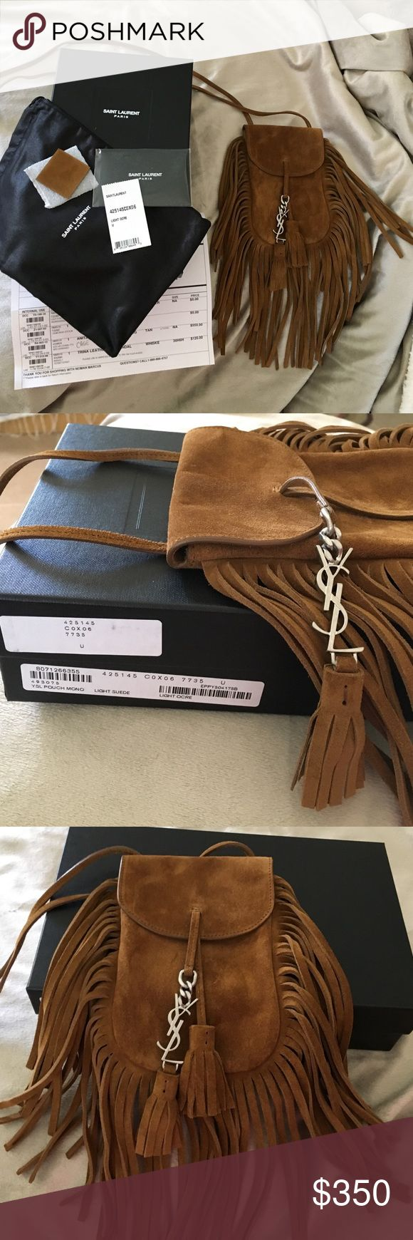 Saint Laurent Mini Anita in color light ocre This bag is so cute and screams 70s vibe. I used this bag one time but bought another fringe bag and didn't used this one. This bag fits an iPhone 6s but won't fit a 6 plus unless you don't mind not snapping the flap. This would be great for a night out or a music festival where you only need the bare minimum. Saint Laurent Bags Mini Bags