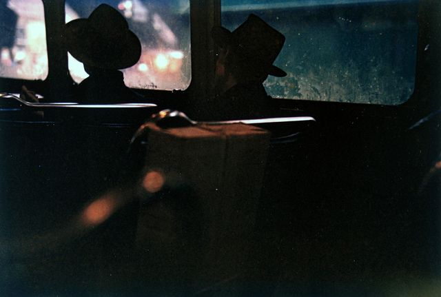 Saul Leiter | Untitled (two men in hats on train at night) (1950) | Available
