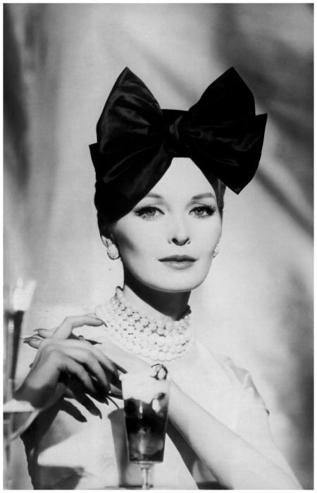 Sara Thom wearing a Lilly Daché hat, 1959
