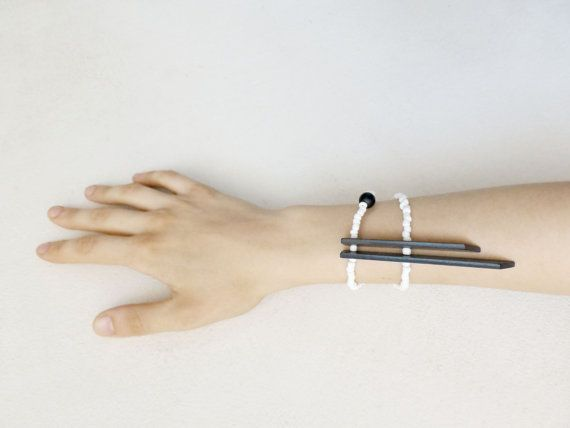 minimal tribal bracelet with black sticks and white by pergamondo